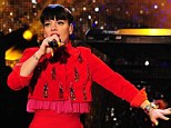 Red devil: Lily sings her heart out on The Graham Norton Show last month
