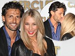 Revving up their romance! The Bachelor's Tim Robards and Anna Heinrich take their love trackside in Melbourne