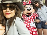 Two cute: Katie Holmes shows off her toned pins in Daisy Dukes while posing playfully with Minnie Mouse at Disney World