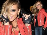 Reow! Carmen Electra channels Catwoman with feline eyes and head-to-toe leather at infamous rock 'n roll hotspot