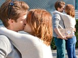 Like nobody's watching? Emma Stone and boyfriend Andrew Garfield engage in starry-eyed public smooch-fest
