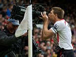 Back again: Gerrard celebrates scoring the second goal by kissing the camera, just as he did five year ago