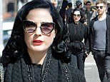 The purr-fect date! Dita Von Teese oozes Hollywood glamour in cat eye glasses as she holds hands with mystery man