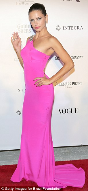 Looking good: Adriana Lima's gown came with embellishments across the right shoulder and hip and cut-out panel that revealed the arch of her back