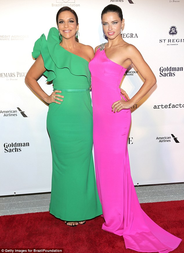 Quite a pair: Adriana poses for a photo with Brazilian singer and TV presenter Ivete Sangalo