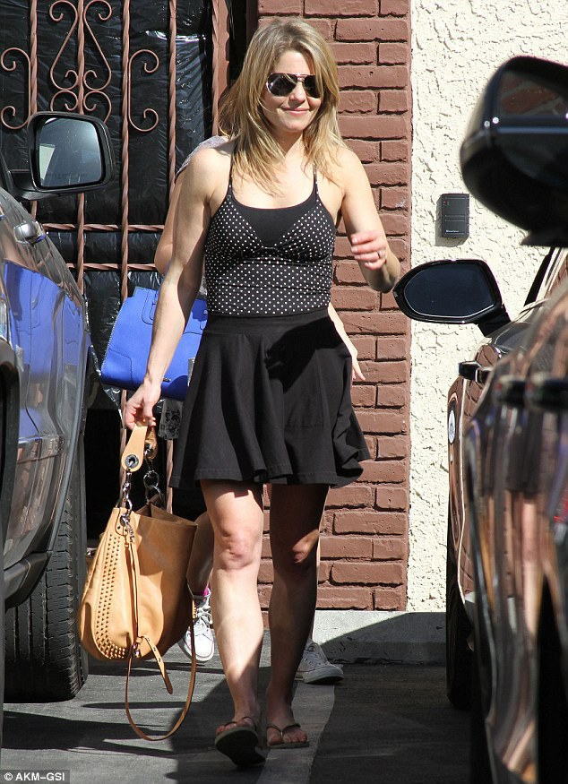 Ready to compete? Full House star Candace Cameron Bure wore a flirty black skirt teamed with a polka dotted spaghetti strap top