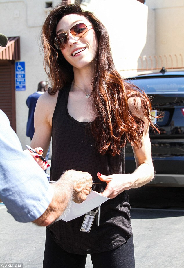 Beautiful brunette: She shielded her eyes with a pair of aviator sunglasses and wore her hair long and loose
