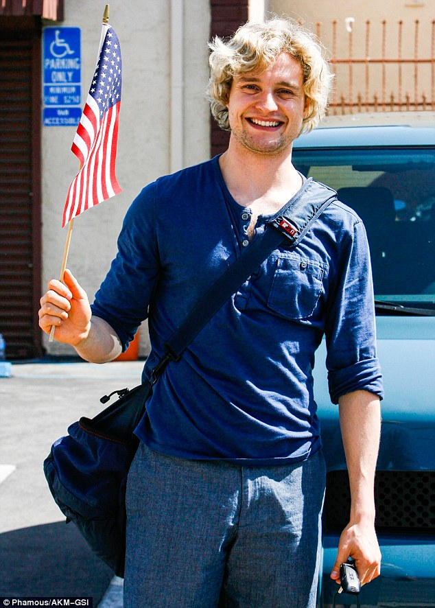 Showing off your patriotism? Olympic ice dancer Charlie White wore a preppy blue shirt, teamed with jeans, as he waved an American flag