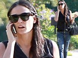 Youthful appeal: Demi Moore dressed younger than her 51 years of age with a tattered pair of jeans as she attended a friend's birthday bash in Beverly Hills, California on Saturday