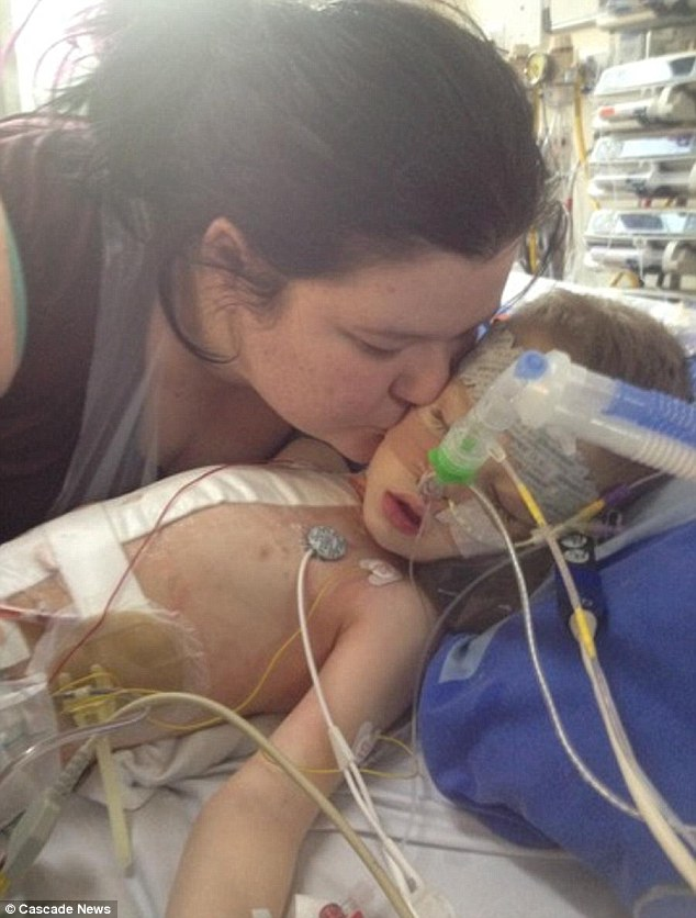 Mother Shanna kissed her son who was admitted to hospital with a rare condition which usually only affects adults