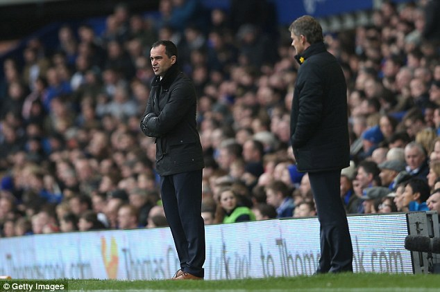 Happy man: Roberto Martinez (left) heaped praise on match winner Seamus Coleman