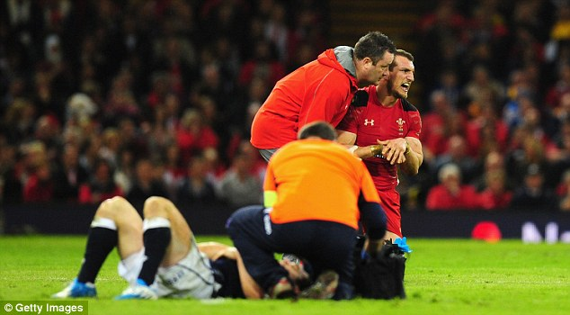 At a cost: Sam Warburton dislocated his shoulder in the victory and will miss the South Africa matches in the summer