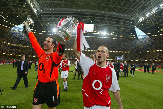 Glory days: Seaman lifts the 2003 FA Cup with Arsenal team-mate Fredrik Ljunberg (right)