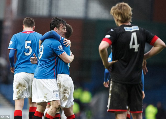 On the ball: Calum Gallagher (9) celebrates after scoring Rangers' second goal against Dunfermline
