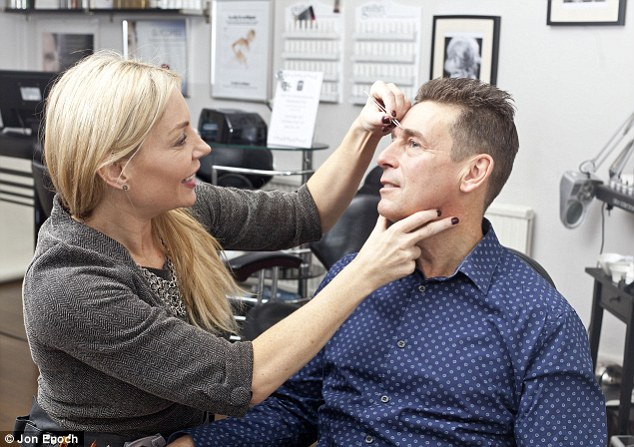 No pain, no gain: Keith Yexley having his eyebrows shaped by Kerie Hoy at her Salon in Hitchin