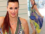 Flawless Kyle Richards, 45, models plunging halter-neck dress at her Beverly Hills store... but where are the customers?