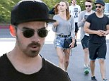 Leggy lady: The 24-year-old musician and his 29-year-old girlfriend were dressed for warm weather, with Blanda showing off her toned legs in a high-waisted denim shorts and flip flops
