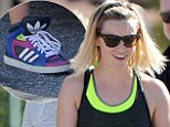 Reese Witherspoon attempts to pull of bright fashionable trainers on an LA stroll with her teenage son, Deacon