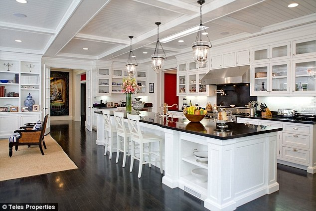 Gorgeous: The amazing kitchen features a huge island, black counter tops and stainless steel appliances