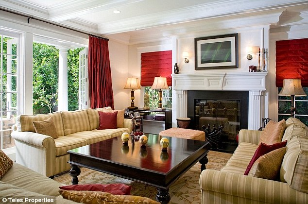 Cozy: The formal living room features a fireplace and large doors that open to a veranda