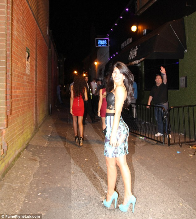 Runway ready: The TOWIE star seemed to be using an alleyway as a catwalk as she posed up a storm outside the club