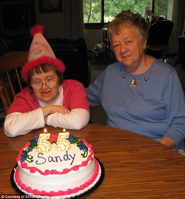 'One soul': Sandy and Sharon Schulte seen here two years ago on Sandy's 55th anniversary. Her health started to decline around this time