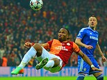Old pals: Didier Drogba attempts an overhead kick against Chelsea last month as John Terry watches on