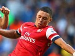 Winning team: The Ox chases down England team-mate Andros Townsend during the north London derby