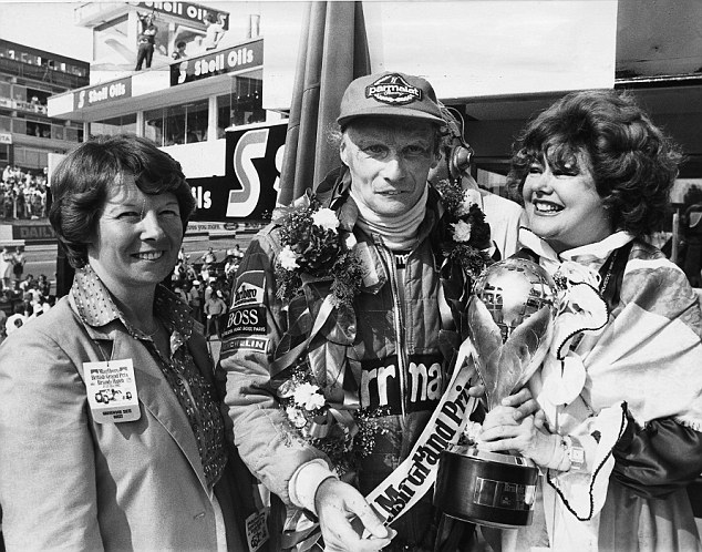 Heyday: Niki Lauda receives the trophy after winning the British Grand Prix