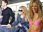 Beautiful game: Shakira admits that football is a huge part of her life with Barcelona's Gerard Pique