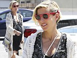 Elsa Patakaky shopping