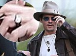 Treasured possession: Johnny Depp looking ecstatic wearing a ring outside his engagement party