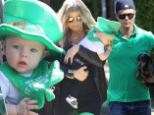 Fergie and Josh Duhamel dress in green, matching son Axl's leprechaun hat, for a St. Pat's party in Los Angeles Sunday