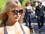 Goldie Hawn looks posture-perfect in skin tight workout clothes while on a Sunday stroll with a friend