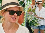 Makeup free mama! Naomi Watts is au naturel while picking up flowers at a farmer's market with sons in tow