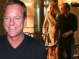 Making the most of his time: Kiefer Sutherland was spotted with a mystery blonde during an evening out in the capital