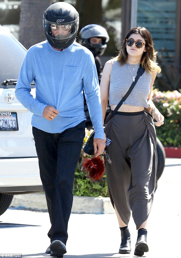 Suddenly shy? Bruce Jenner enjoyed some bonding time with Kylie, 16, in Malibu on Sunday but hid his face under a motorcycle helmet