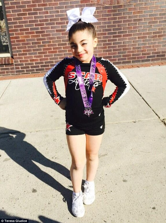 Star in the making: Milania, 8, showed off her gold medal after her squad was placed first in the competition