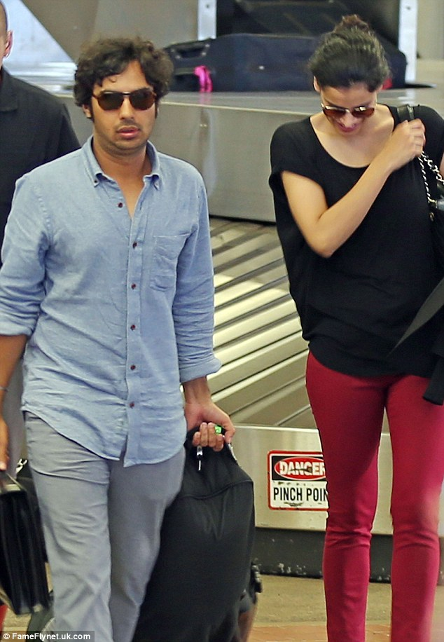 Long journey: The couple looked tired after their flight to the island, which was delayed by eight hours