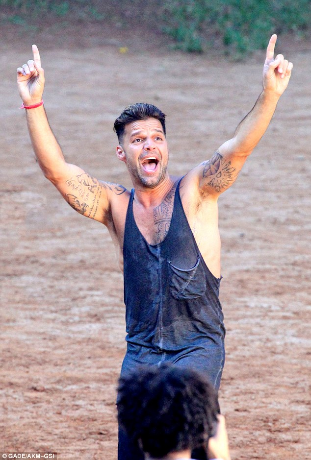 High energy! The star's grey tank top was drenched in sweat as he filmed his music video Vida, which will be part of the official soundtrack for the 2014 World Cup