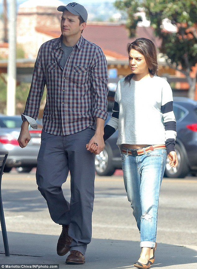 Headed for matrimony: Ashton Kutcher and Mila Kunis, pictured on March 7 in Beverly Hills, are engaged