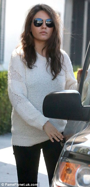 Keeping a secret? The 30-year-old fiancee of Ashton Kutcher has been spotted lately wearing various baggy outfits that appear to be hiding her midsection