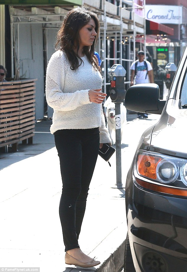 Comfy: The Ted star didn't mind showing off her slim legs in tight skinny jeans but her midsection was another story