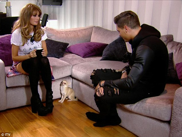 Charlie and Mario talk about dog obedience on the sofa