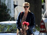 It's the little things: Julia Roberts brought her mother Betty Lou roses to her home in Pacific Palisades Sunday as the pair attempt to get back to normal