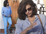 Eva-ry inch a Hollywood star: Actress Mendes makes baggy jeans and oversized shirt look chic with Chanel shoes