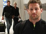 Proving a point? Juan Pablo Galavis and Nikki Ferrell held hands as they arrived in the airport in Miami