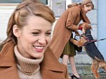 Lovestruck! Blake Lively looks elegant in camel coat and olive skirt while greeting her affectionate furry co-star on film set