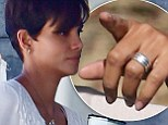 The ring of truth! Halle Berry signals that her marriage to Olivier Martinez is far from over as she waves wedding band on set