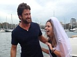 All dressed in white: Gerard Butler helps Sydney girl, Maja Nogic celebrate her hen's party on the weekend